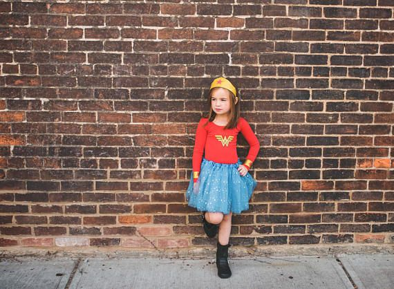 Calling all superheros! Are you here? Good! We need your help! Do you think you can help by letting your little one wear this adorable Girls Wonder Woman Costume for Halloween this year? Why? Because, we are on a mission to bring happiness to all the little girls this Halloween!  Fighting crime and collecting candy is the name of the game! Whether she is knocking on doors or getting Fall Pictures done, she is sure to be the best dressed hero on the block!   You choose the outfit! Do you need…