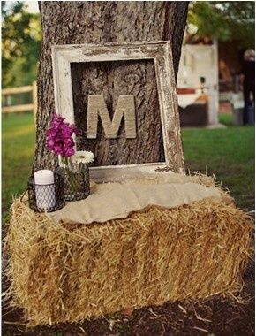 hay bale wedding decorations | Framed letter of your last name resting on a hay bale | Wedding Ideas