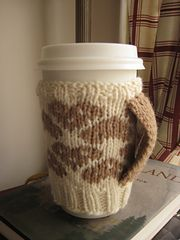 Ravelry: Mandolin Mug Mitts pattern by Erica Jackofsky (Fiddle Knits)...love the little handle