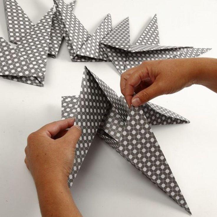 Sterne aus quadratischem Papier mit 7 Zacken
