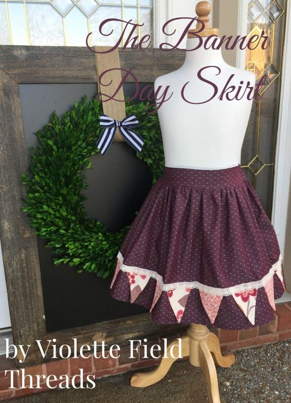 The Banner Day Skirt features a simple full skirt with a fun bunting banner that can be attached either straight across the hem or in a whimsical pattern across the skirt!  The little bunting flags are only sewn down along the top, which allows them to flap up and down in the wind.