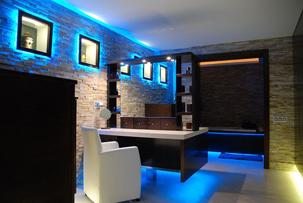 Dressing room with custom made furniture and decorative LED lighting.