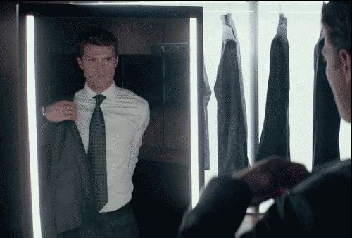 """Here he is putting…on a suit? No. No, Christian. You're doing it wrong.   Christian Grey Strips Down In The New """"Fifty Shades Of Grey"""" Trailer"""