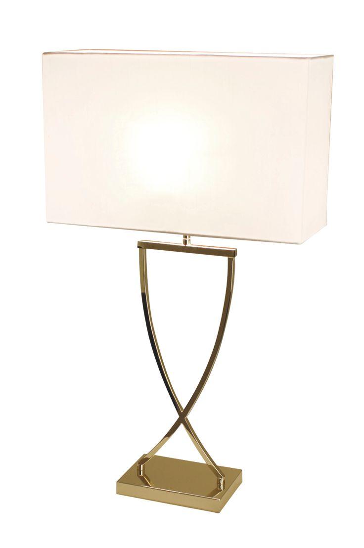 Bordlampe Omega i blank messingfarge inkl skjerm, E27 stor pæreholder med strømbryter på den  transparente ledningen. Totalhøyde 69 cm, bredde 40 cm, dybde 16 cm.