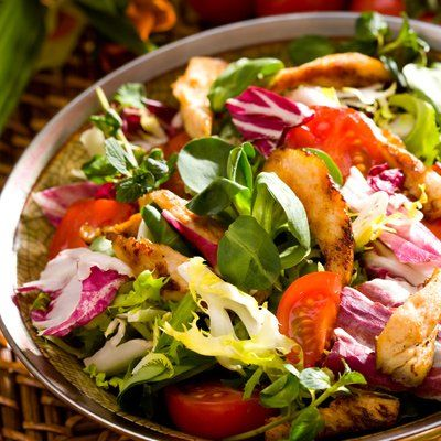 *large salad filled with nuts, fruits, eggs, & lean meat