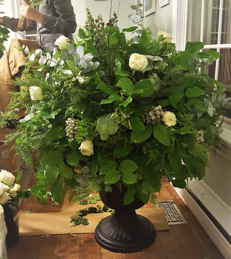 Winter wedding, large urn arrangement for wedding decor.  Garden roses, brunia berries, baby euc. parvifolia.