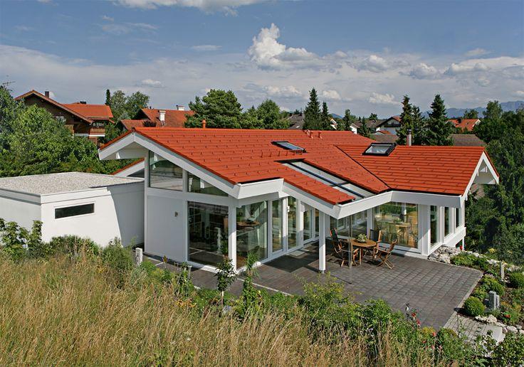 Kundenhaus - Osterseen | Außenansicht mit Blick auf Terrasse | Finden sie mehr Informationen zu diesem Kundenhaus auf https://www.davinci-haus.de/kundenhaus/osterseen/