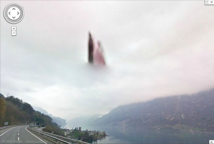 """What did Google Maps cameras discover over a lake in Switzerland? Google Maps have been taking """"street view"""" images for a number of years, and they've captured some interesting things... There's a ghostly figure that appears over a lake in Switzerland. Go to Google Maps. Copy and paste these coordinates for the location: 47.110579, 9.227568. Zoom in until you are in street view. Then look to the sky (North-West over the lake). Was this just a strange camera anomaly? or something more divine?"""