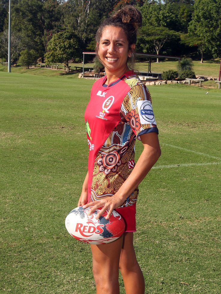 Queensland Women's Sevens player Talisha Harden models the unique jumper with which the Reds will mark National Reconciliation Week