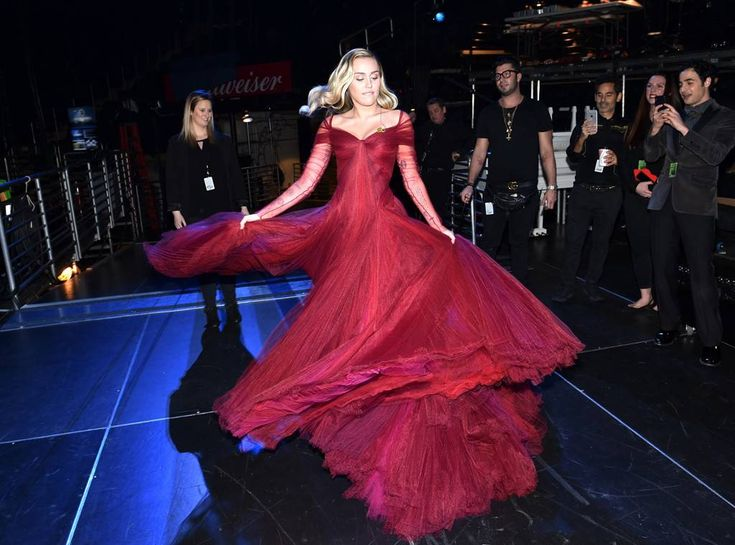 Miley Cyrus from Grammys 2018: Candid Moments  The polished performer gives her Zac Posen gown a twirl.