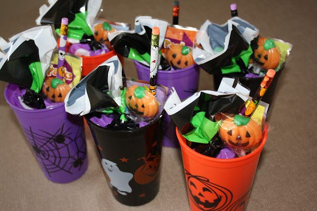 gift bags Cups: draw on them.  colours purple black orange  Halloween Happiness:  Fun Ideas for Children's Halloween Party