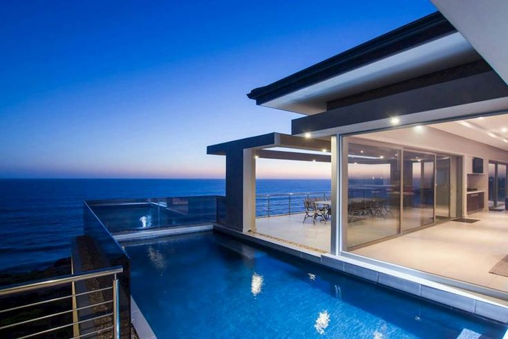 #HomesInWesternCape #PropertyForSale # Mossel Bay   #CPT #GardenRoute #ResidentialEstates  Situated on the edge of the ocean, this six bedroom home is a majestic architectural masterpiece in the picturesque setting of Pinnacle Point Beach & Golf Estate.