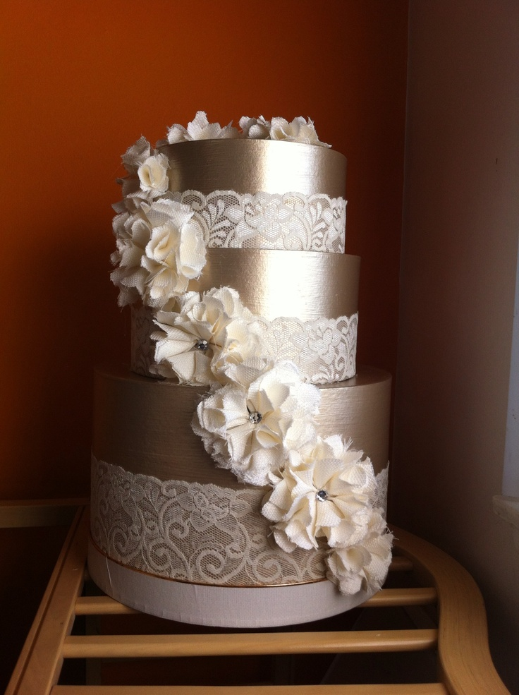 Wedding card box like a cake -- replace the fabric flowers with white Chanel-inspired paper flowers.