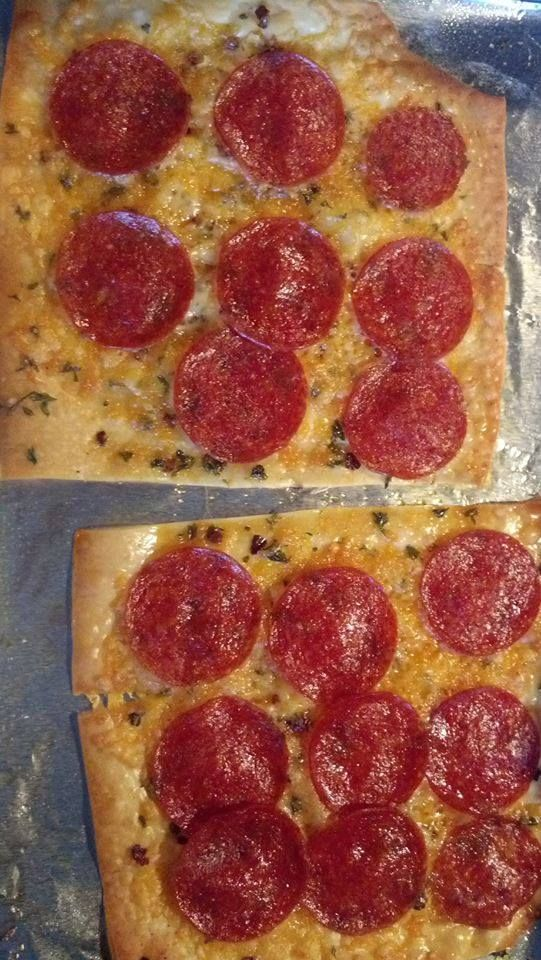 Bonita Tellier's Egg-Roll Wrapper Pizza: I spray the wrapper with Pam ( and your cookie sheet!), put a little cheese, pepperoni , garlic and Italian seasoning on and bake at 350 for 10-15 min. It gets really crispy...