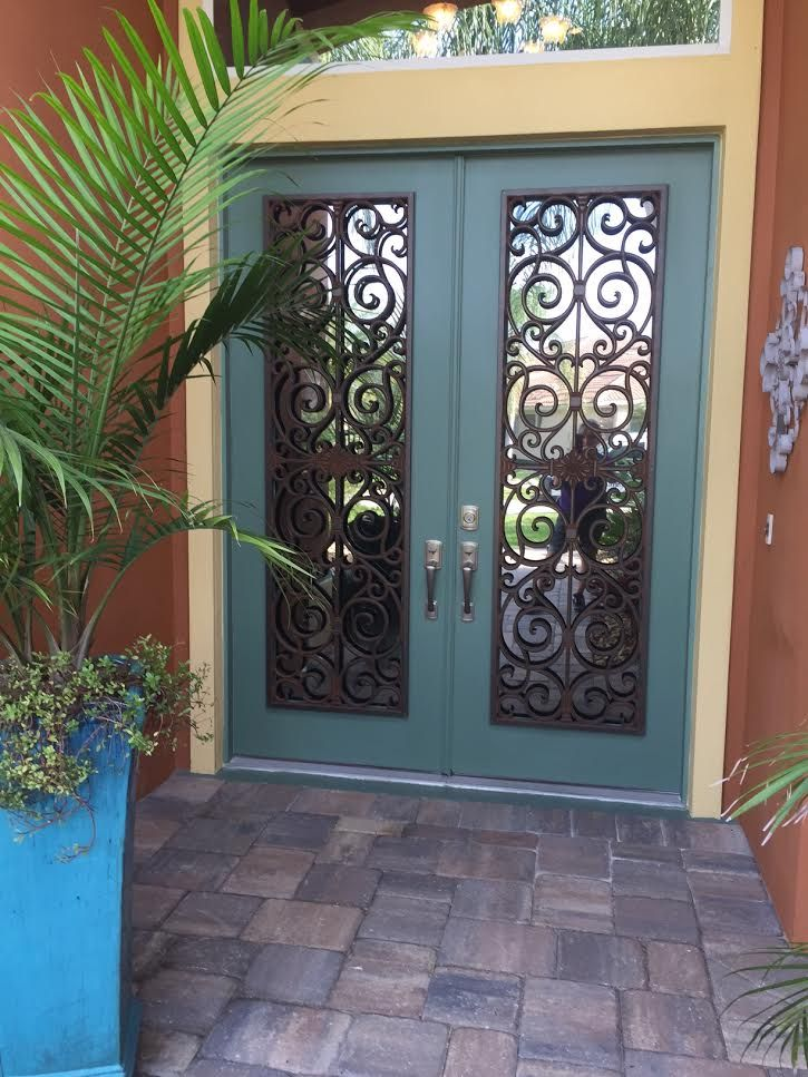 """Kim loves her Faux iron overlays for interior and exterior glass doors by Tableaux! """"All installed and absolutely love it...thank you for getting it in and installed."""" #BudgetBlinds"""