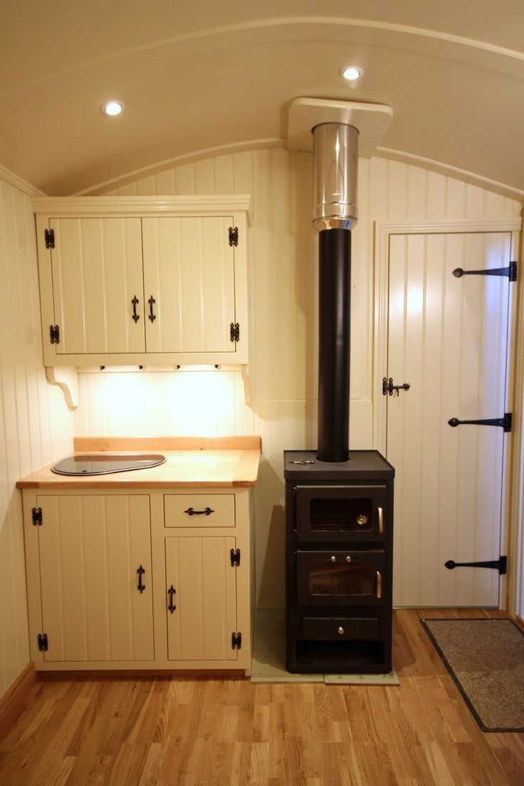Shepherds Hut cooking area with shower room behind- Great small space solution
