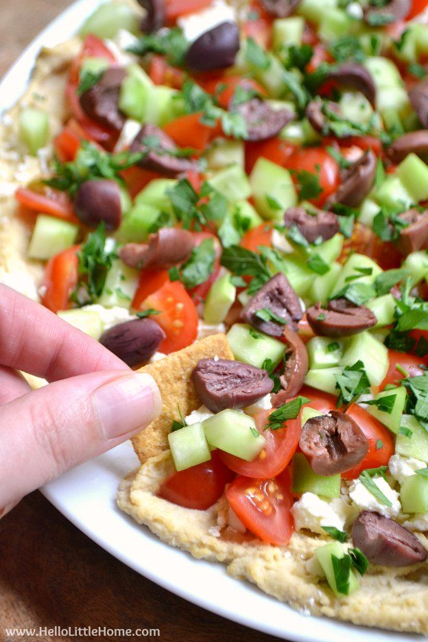 Layered Greek Hummus Dip ... an easy, delicious appetizer recipe that's perfect for your next game day party! | Hello Little Home