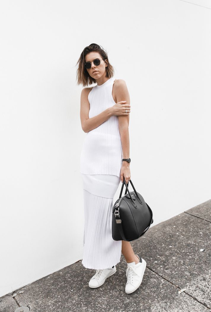 Browse the best summer street style outfit ideas at @stylecaster | 'Modern Legacy' blogger @kaitymodern's white separates, sneakers, black purse