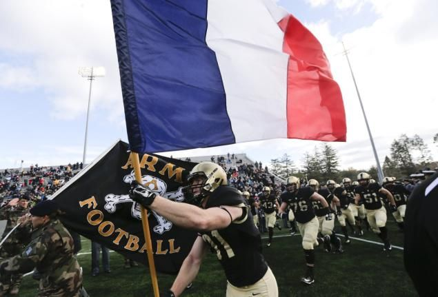 Army football team takes field with flags of France and U.S.