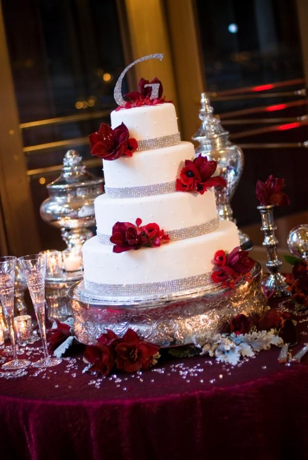 The Sacramento Grand Ballroom, located in Sacramento, CA. Wedding Cake with rhinestone edging and fresh red flowers.
