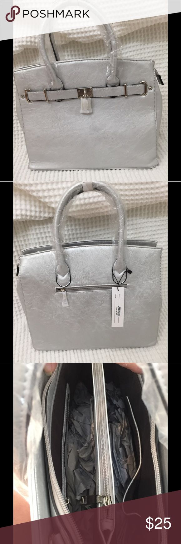 Silver bag New with tags.  Zipper compartment on back of bag.  Inside, there are two sides separated by a zippered middle section. Two open pouches on inner wall to hold phone, etc.  one small zippered compartment on other wall of bag.  Outside is a soft silver finish, with chrome accents and decorate lock on front of bag.  Includes a removable shoulder strap.  Bag is approximately 14 inches wide, 10 inches tall excluding handles, 6 inches wide at base of bag. sociology Bags Totes