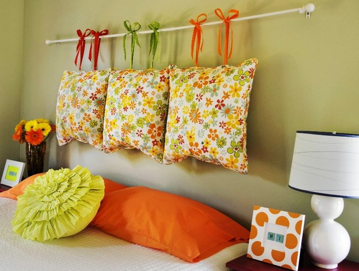 I have been looking for easy DIY ideas for a headboard.. and i have a few extra pillows laying around the house.. and i think i will put them to some good use!.. :)