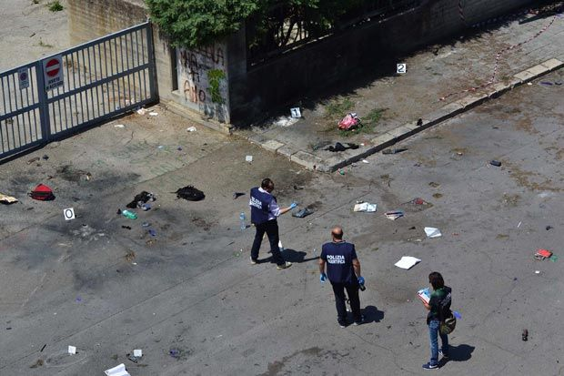 2012 - Brindisi, Italy. Horror at school: books, backpacks and diaries burned on the ground after the bomb