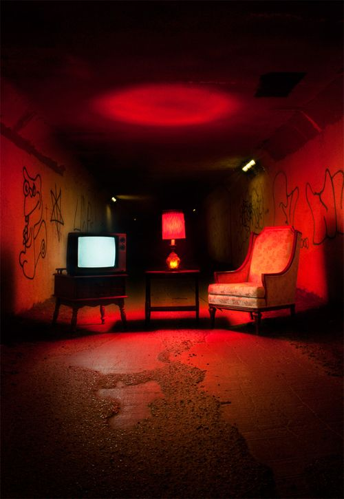 Room lit with red + set pieces