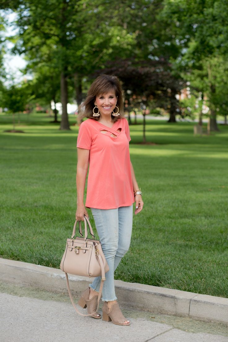This summer cold shoulder and off the shoulder tops are everywhere but the criss-cross trend is out there too. This is a cute and casual top.