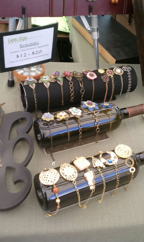 Wine Bottle Bracelet Display.  Magnet on top to keep bracelets from sliding off, mat board on bottom to keep bottle from rolling (I'm going to use 1 of the flat slate pieces I have).  Love it!  Display at top of pic looks like a Pringles can!