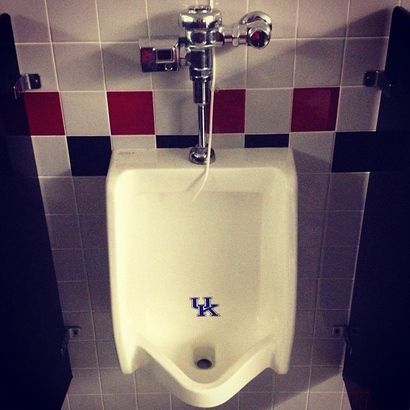 According to the blog Big East Coast Bias, Louisville Cardinals head football coach Charlie Strong had the urinals in Louisville's football facility adorned with brand new University of Kentucky logos.