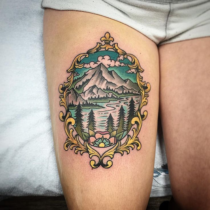Frame with Mountain and Lake Scene inside Color Tattoo - Chris Benson