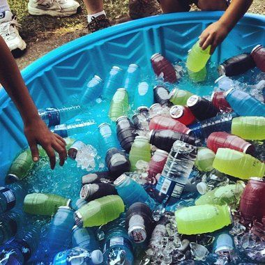 Drinks in kiddy pool allows guests to see a variety of easily accessible beverages while keeping them cool.  Great idea for a July 4th bash or any outdoor gathering.
