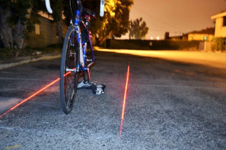 Xfire safety light projects two red lights along either side of the bike, creating a more literal bike lane.