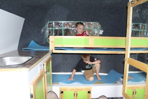 Boys trying out the beds