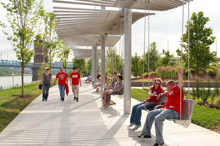Mobility + Connectivity (&) Aesthetics + Design –Swings overlooking walkway and river at John G. and Phyllis W. Smale Riverfront Park