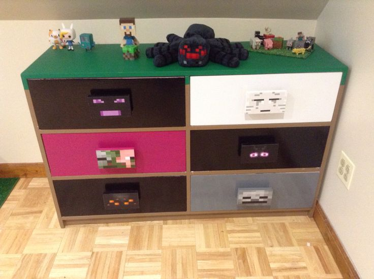 I painted the dresser to look like a dirt block and then each drawer is a different Minecraft Villain. It wasn't as hard as you might think. If you have questions, comment. I'll answer.
