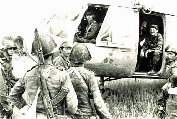 Cuban soldiers and officers in Angola consult with each other in the field. Date unknown.
