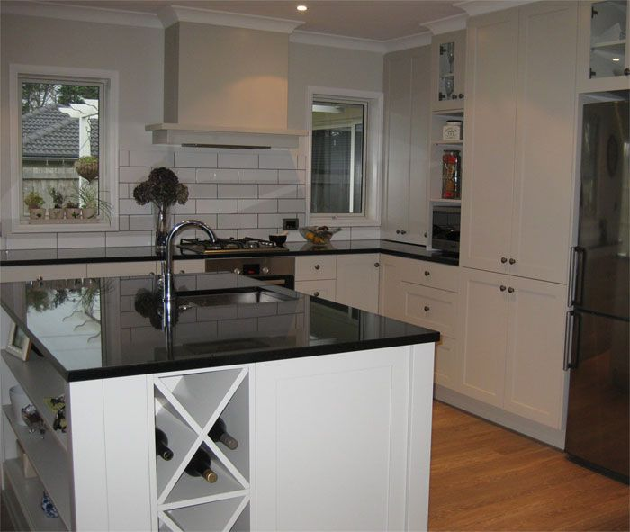 Resene White Pointer and Resene Alabaster with Resene Triple White Pointer for the kitchen cabinetry