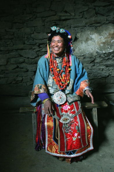 Tibetan lady with necklaces and headpieces