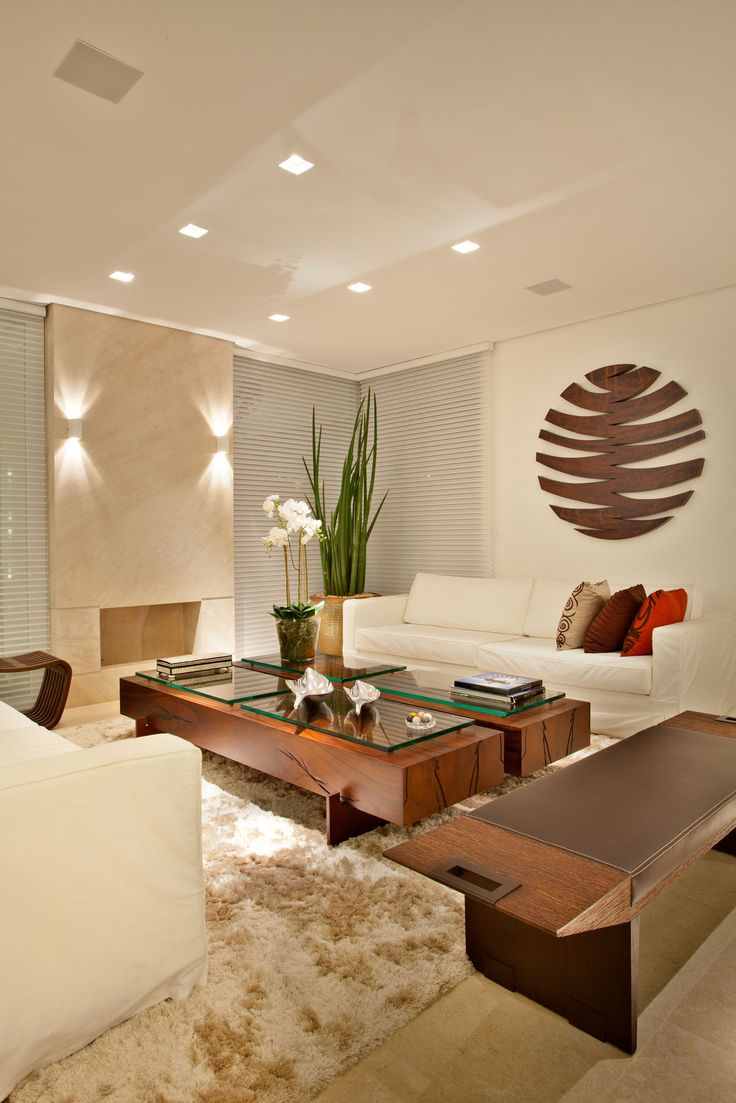 Pupogaspar Arquitetura. Love the decor and lighting in this neutral living room.