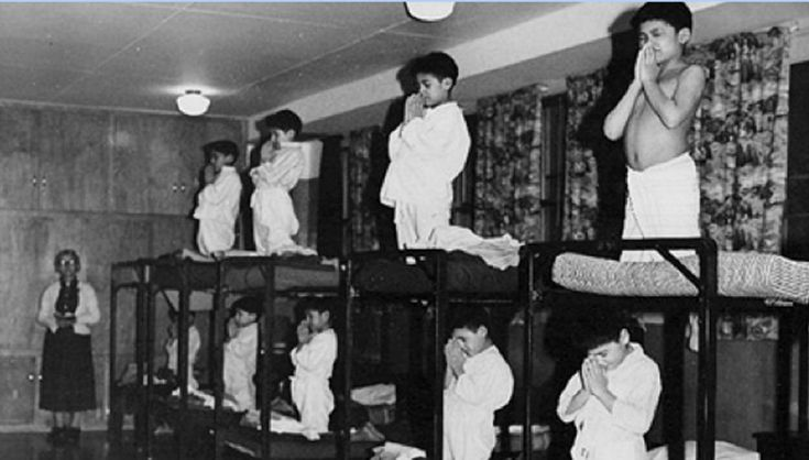 Indian Residential Schools (IRS) were first introduced to Canada in the 1920s. The government's goal was to take native Americans and bring them into Canadian society. These schools were run by the church. Unfortunately, the children were abused, malnourished and mistreated. This school program continued until 1990 where the final Indian Residential school was finally closed. (This photograph shows native american children praying before bed 1920)