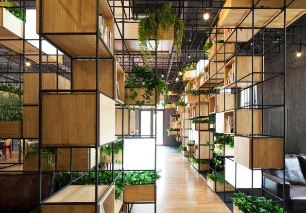 Architecture firm Penda have designed the interiors of Home Café, using recycled steel bars as dividers