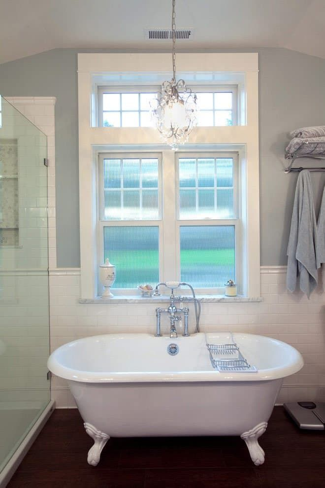 fancy bath lighting inspiration and tips for hanging a chandelier over the bathtub
