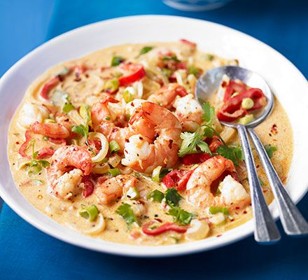 Bahia-style Moqueca prawn stew. A Brazilian-inspired seafood casserole with creamy coconut sauce, coriander garnish and plenty of sunshine spice