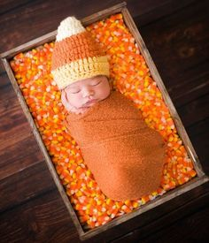23 Pumpkin and Halloween photography ideas for pictures of kids and candy corn and other holiday fun. This newborn in a bed of candy corn is so adorable!