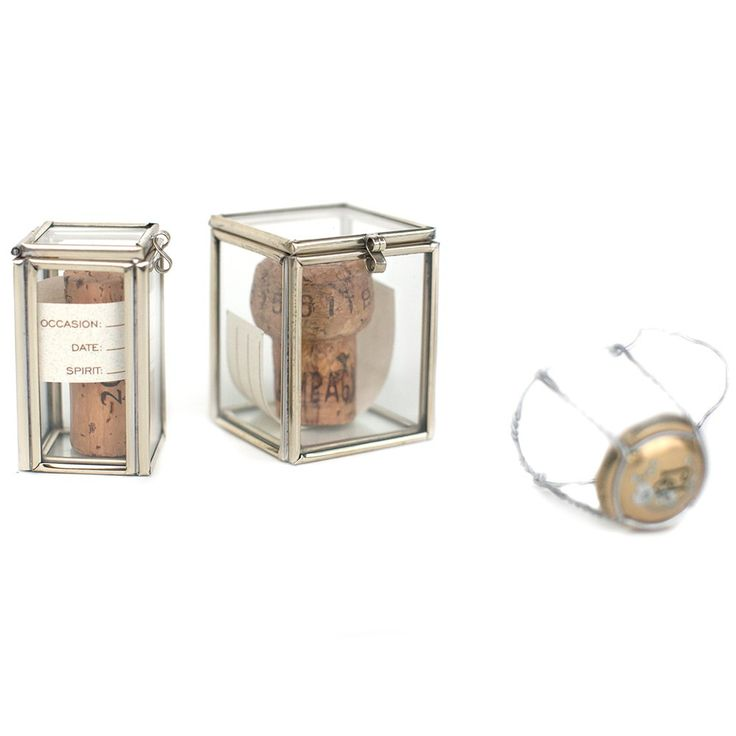 These charming hinged glass boxes are a way to preserve that special moment once the cork has been popped, the toast has been said, and the bottle has been emptied.