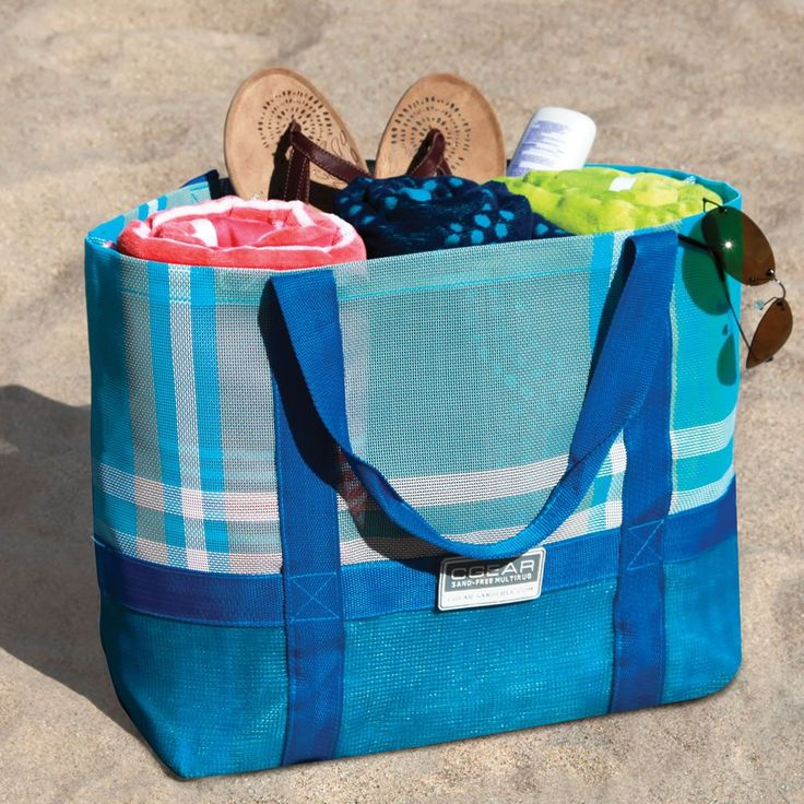 Must have - Sandless beach tote - the material is made from two layers of patented woven PVC/PE that instantly filter sand to the beach as soon as it falls on its surface. The specially woven polyurethane acts as a one-way filter to prevent sand from reemerging through the bottom or sides of the bag.Sands, Beach Totes, Beach Mats, Beach Bags, Fall, At The Beach, Hammacher Schlemmer, Military, Sandless Beach