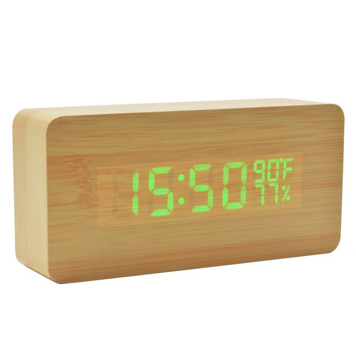 Digital travel alarm clock with temperature and humidity, battery operated and voice activated.