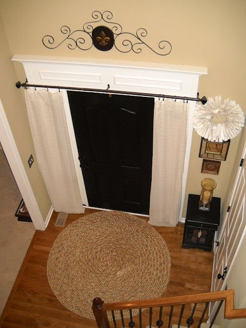 Entryway--noticing how they did a long curtain rod over the door